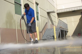 pressure washing using steam